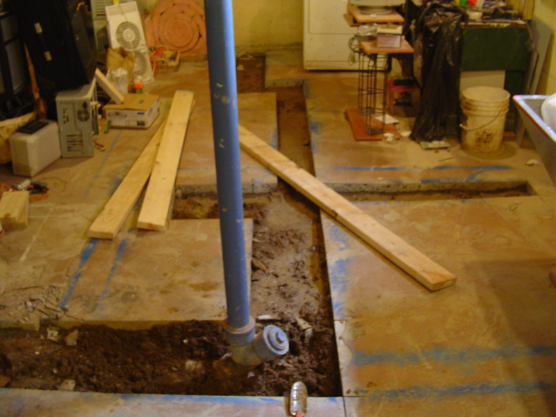 concrete cut and cleared for the new sewer pipes
